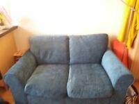 Beautiful 2 seater teal soft sofa