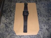 A hardly used battery operated Avon watch in very good condition.