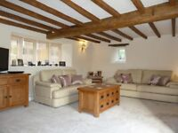 3 Cream Leather sofas, 1 Swivel chair and 1 footstool.