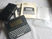 Psion Series 3 vintage hand held PDA with Leather case, User Guide, Programming Manual and paperwork