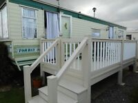 31 ft static caravan sited near great yarmouth with decking