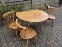 Restored; Ercol oval drop leaf dinning table and 4 Candlestick chairs.