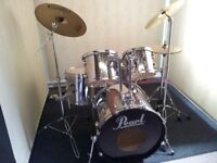 Retired drum teacher has an 'all chrome finish' Pearl Export series drum kit for sale.