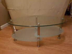 Oval shaped glass table