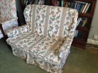 Traditional Style two seater sofa with loose covers.