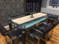 Glass table with 6 dining chairs.