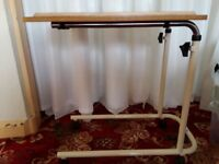 Adjustable over bed trolley