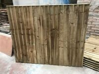 Wooden fence panels pressure treated green