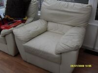 2 x cream leather armchairs