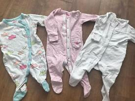 Bundle of next girls sleepsuits and vests 3-6