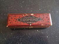 vintage harmonica in original box