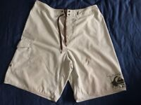 "Mens Quicksilver board shorts - good condition. 32"" waist. Cream colour."