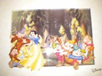 A WALT DISNEY LITHOGRAPH OF SNOW WHITE AND THE 7 DWARFS 24X20 INCHES