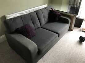 Large charcoal three seater sofa