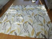 Pair of yellow/beige flower pattern eyelet curtains