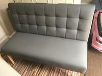 Gray leather bench