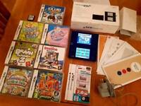 Nintendo DSi boxed original papers and 8 games
