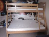 Double bottom bunk and single top bunk beds