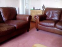 Two brown leather sofas. Each 5ft long.