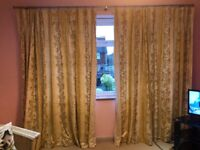 Pair of gold patterned curtains