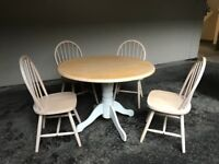 Pine dining table and chairs set.