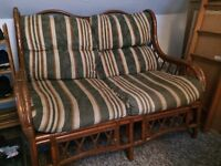 Two seater sofa with wooden frame