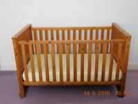 Solid wood pine Cot and later Bed with Mattress. RRP£285 Free delivery available in Leicester. VGC