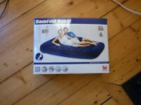 Inflatable camping bed