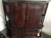 Mahogany Tv cabinet ...frame in wood...not veneer good cond.can store Dvd and space for books etc