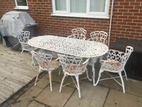 Cast Iron Table and Chairs (x6)