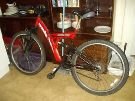Red bike with suspension and 18 gears