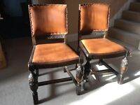 Pair of antique solid carved oak leather dining chairs