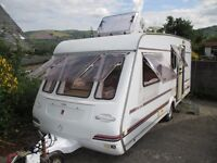 Compass Encore 4 berth family caravan with end shut off wash room with changing area