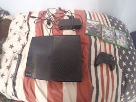 xbox one with 3 games, 1 remote