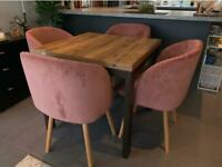 Wooden extendable dining table and pink velvet chairs