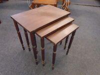 dark wood nest of 3 tables.