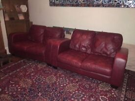 Red Leather Two Seater Sofas, with foot stools