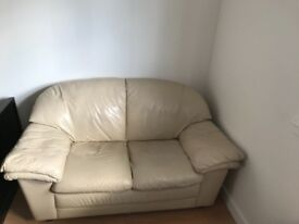 Cream two seater sofa