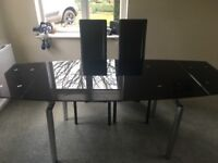 Black glass extendable dinning table and chairs