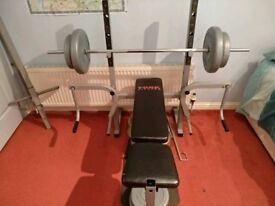 Weights bench with 97kg of plates
