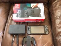 Nintendo switch plus 4 games an accessories