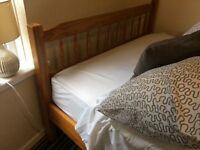 Solid pine double bed frame £40 good condition! Other furniture available as clearing house-phone us