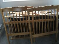 Pine cot/bed, excellent condition, 2 levels, 1 side removeable. Mattress not included