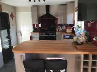 Howdens gloss kitchen less than 2 years old solid wood worktops