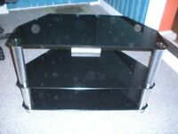TV Stand with Black Glass shelves and Chrome legs- Excellent condition..