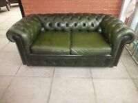 A Large Green Leather Chesterfield Two/Three Seater Sofa