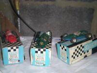 Slot cars for sale with spare engines and tyres and boxes and track and controllers