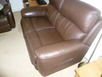 2 seater brown leather settee in excellent condition