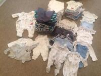 Bundle of boys baby clothes and mittens