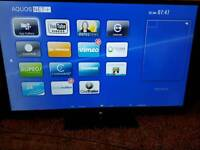 """SHARP AQUOS 60"""" slim WIFI smart 3D tv original stand and remote 4 pair of SHARP 3D active glasses"""